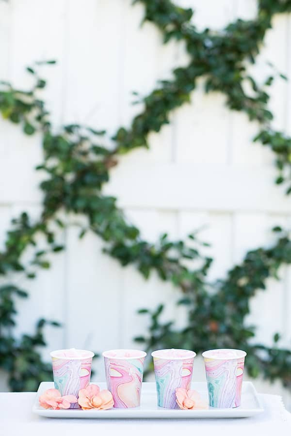 White hot chocolate in watercolor paper cups.