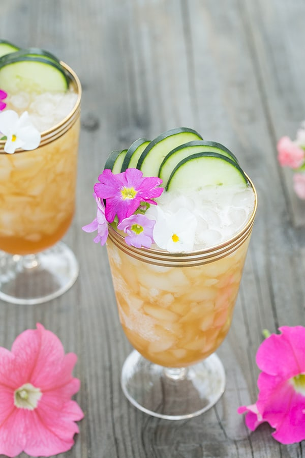Pimm's Cup recipe with crushed ice and cucumber slices.