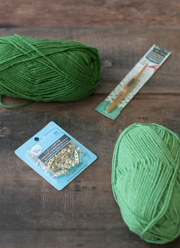 green yarn, pins and crochet hook