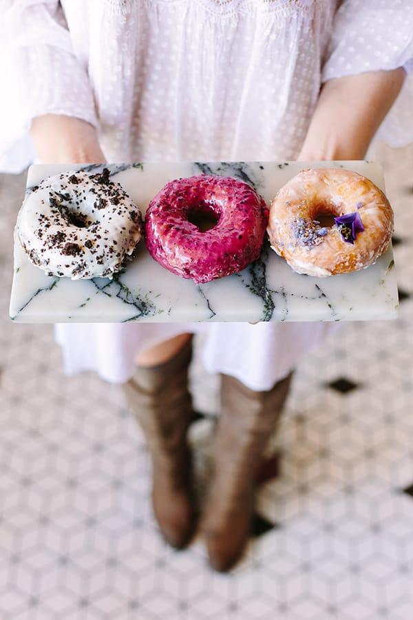 Holding a tray of doughnuts at Sidecar doughnuts