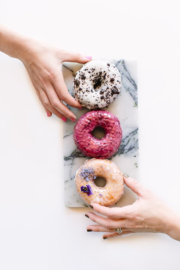 Hand grabbing a doughnut
