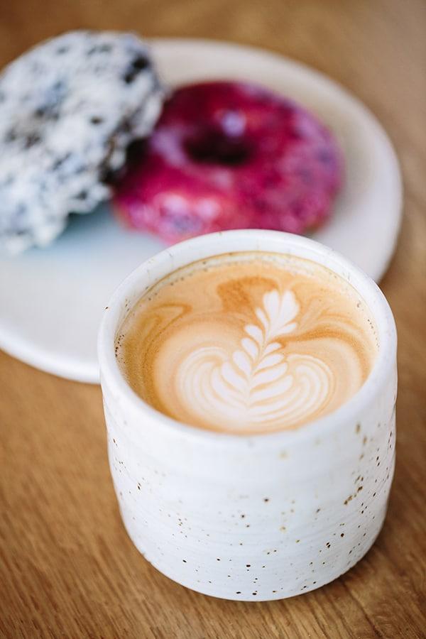 Coffee in white mug at Sidecar Doughnuts
