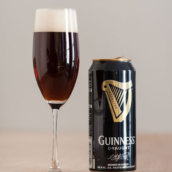 side shot of a can of guinness and a velvet cocktail