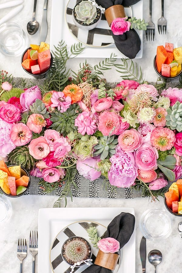 pink flowers on a marble table for Cinco de Mayo