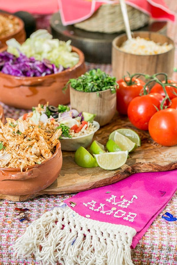 Taco bar ideas and ingredients in wooden bowls.