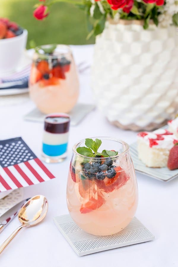 side shot of easy summer cocktails on a table with flags