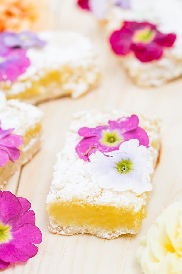 Lemon bars with edible flowers.