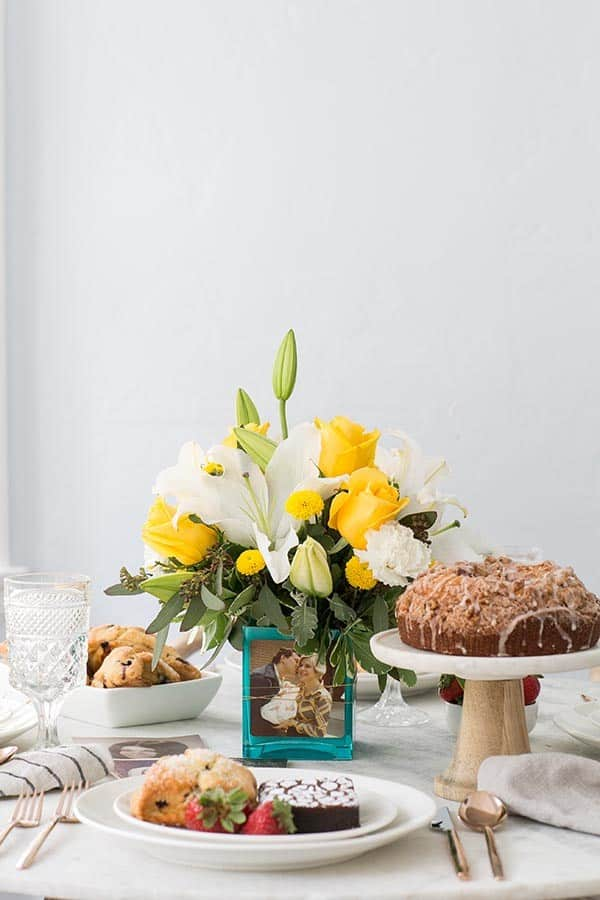 flower arrangement on a table with coffee cake and Mother's Day ideas.