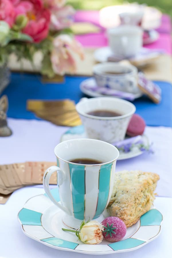 shot of scones and sweets around a tea cup