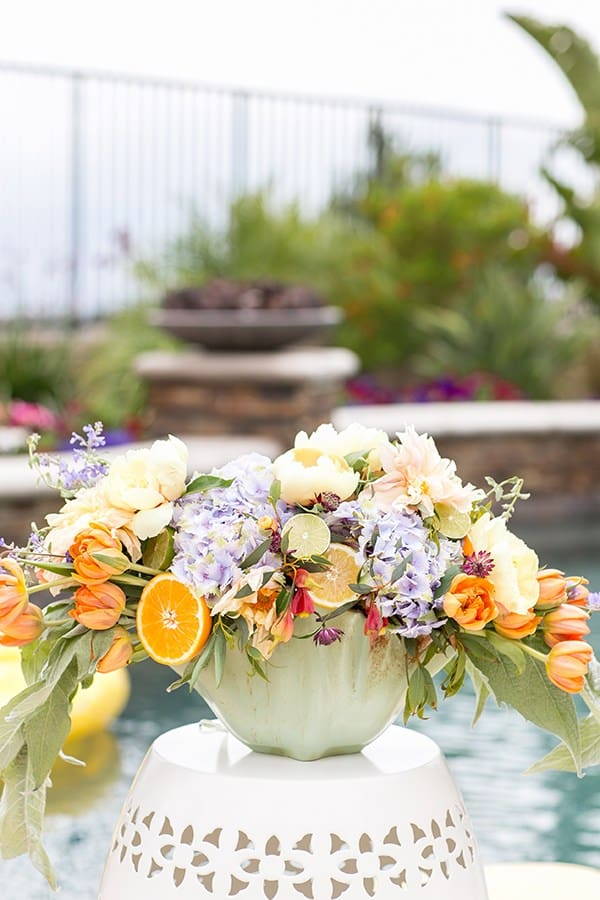 Flower arrangement on a garden stool at a pool party