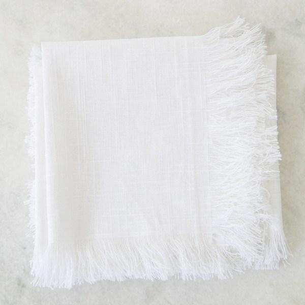 White linen napkin with fringe