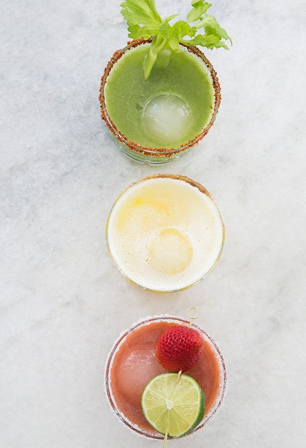 Three healthy cocktail recipes made with fresh vegetable juice and fruit juice.