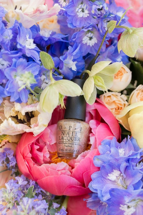 shot of mail polish in a flower