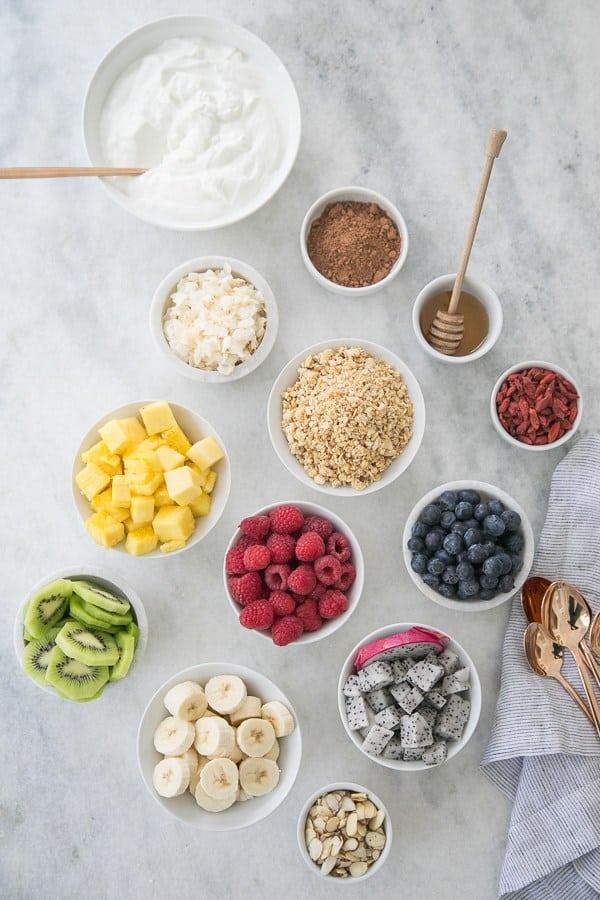 yogurt bowl station with fruit, honey, greek yogurt and more!