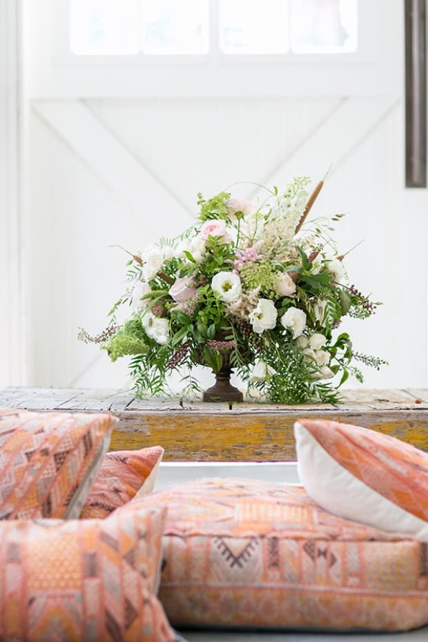 flowers on a table with cushions