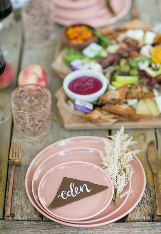 plates on a table with charcuterie board in the background