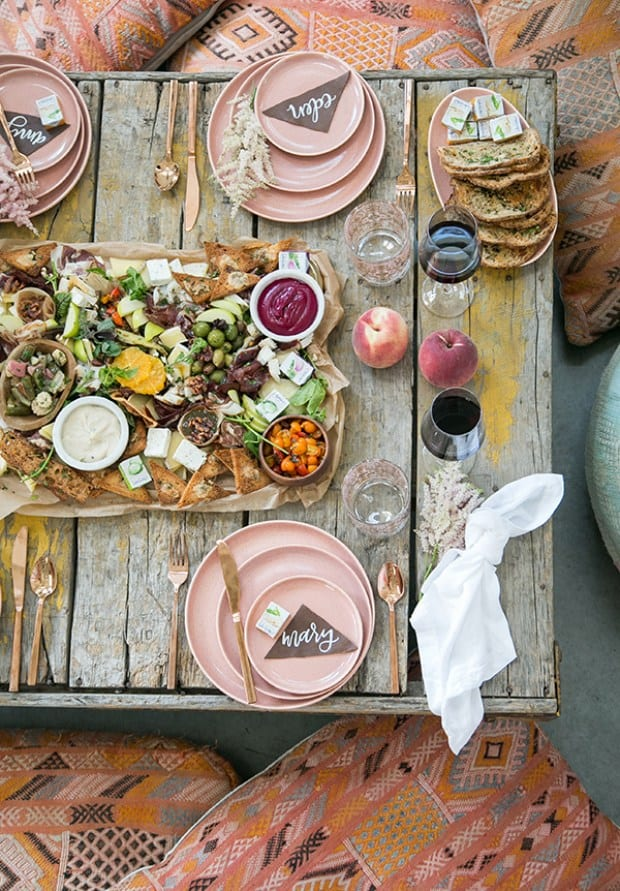 wide overhead shot of charcuterie platter on a table