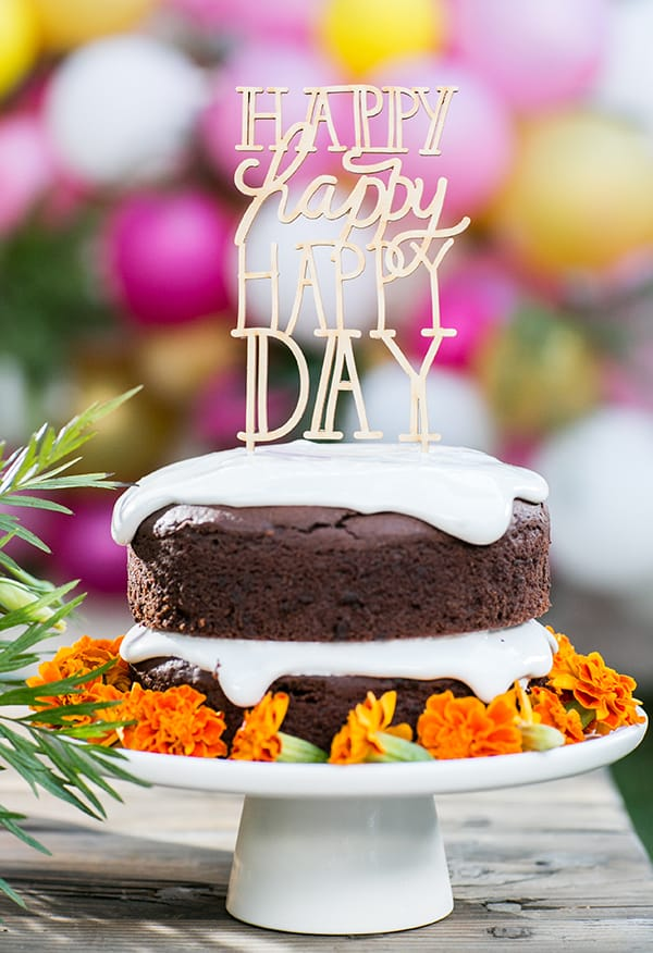 Gluten free birthday cake with happy happy happy day sign