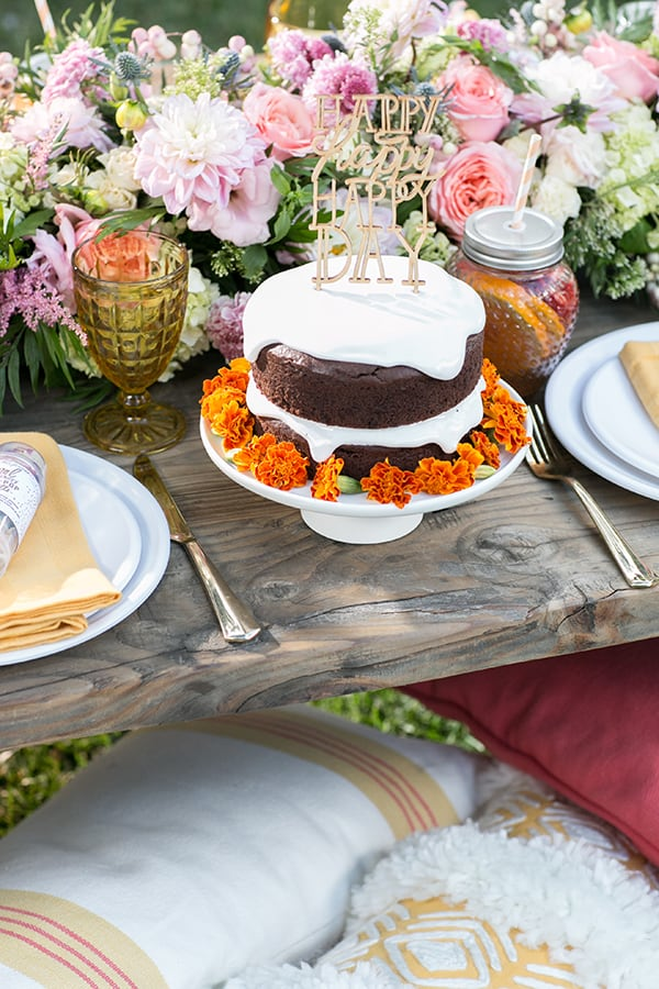 gluten free birthday cake with flowers on a wooden table