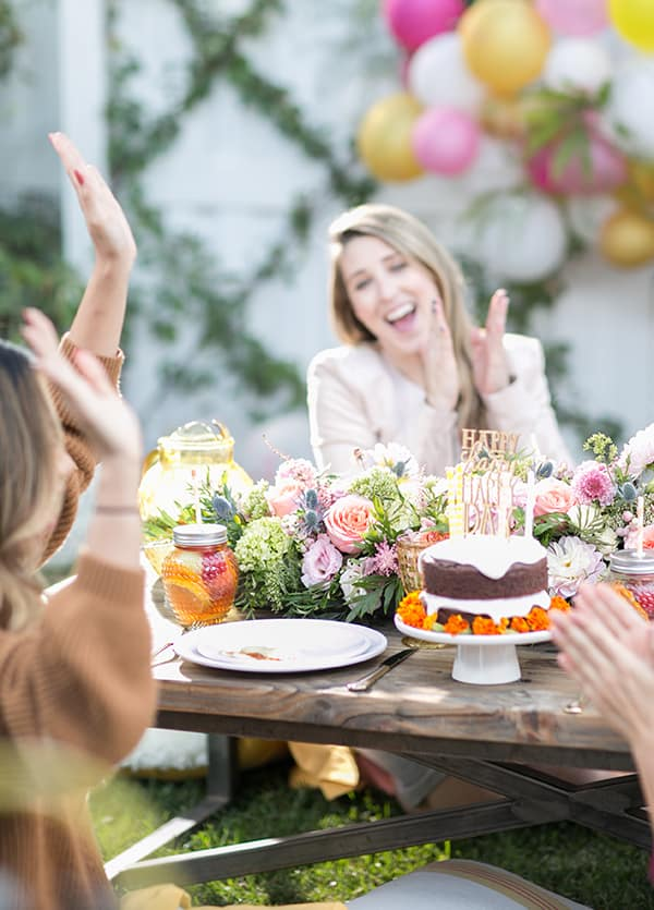 Girls sitting around a table at a birthday party