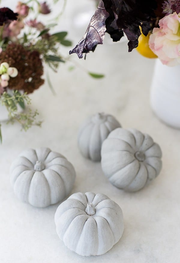4 pumpkin decorations on a table