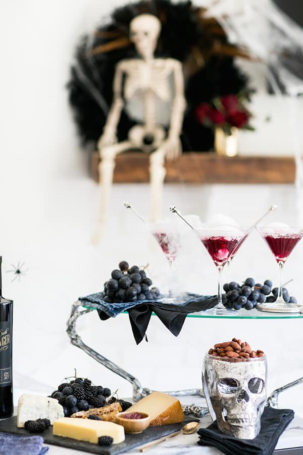 shot of three blueberry cocktails on a table