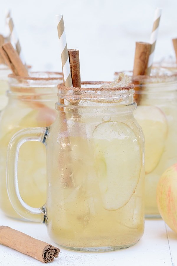 shot of spiced apple cider in jars