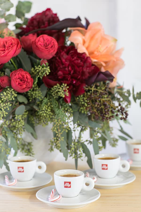 Flowers and Illy espresso in cups