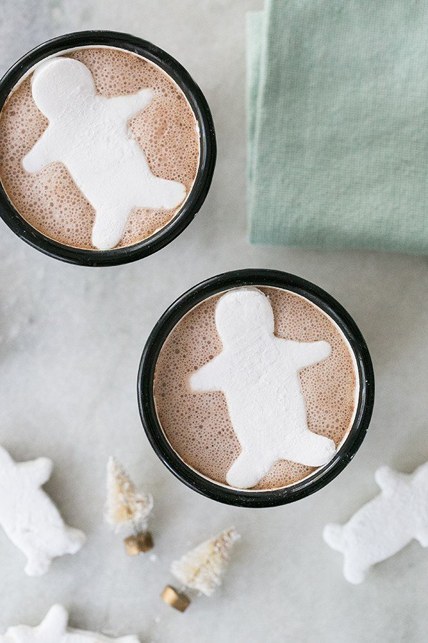 Two homemade marshmallows in a cup of hot chocolate