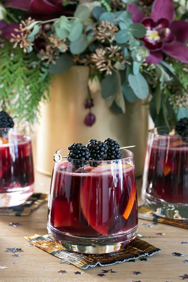 Glass of sangria with blackberries.