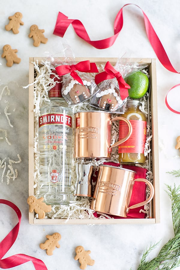 top down shot of gift box with copper mugs and bottle of smirnoff vodka