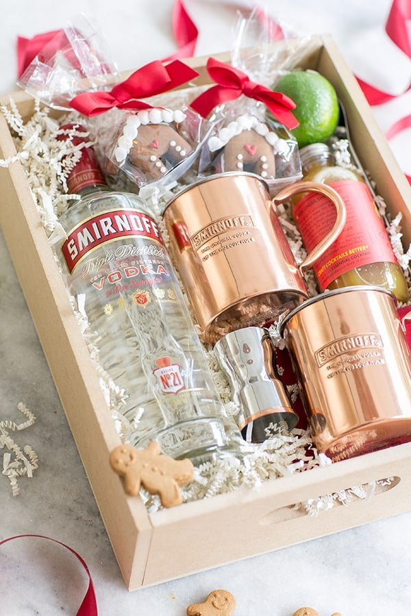 top down shot of gift box with christmas moscow mule mugs