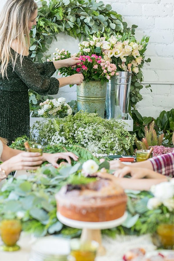 shot of guest picking flowers from a pale