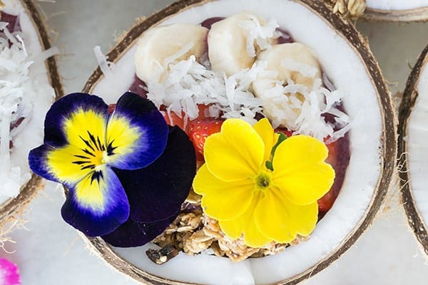 Acai bowl with flowers over the top.