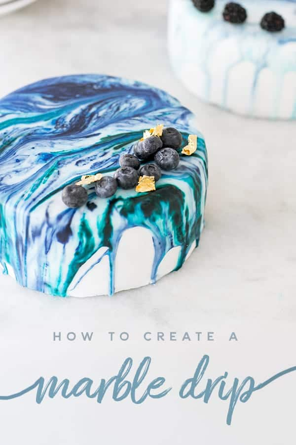 marble cake with blueberries and gold leaf and a marble drip title.