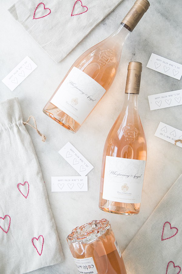 Bottle of Whispering Angel, with DIY Valentine's wine bags and heart labels.