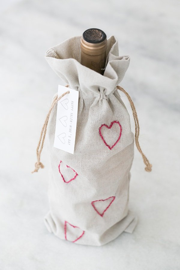 A DIY Valentine's Day Wine Bag with Embroidered Hearts and Printable Wine Label.