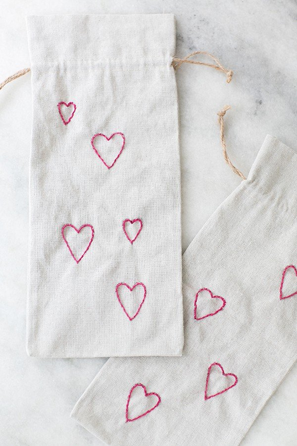 Valentine's Day wine bags with tiny embroidery hearts.