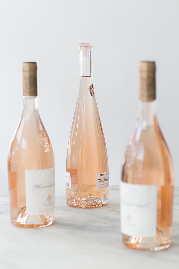 Bottles of rosé on a marble table.