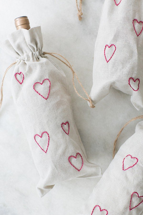 DIY wine bags with rosé inside and pink hearts.