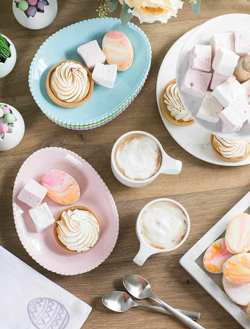 Easter deserts with coffee, cookies, marshmallows.