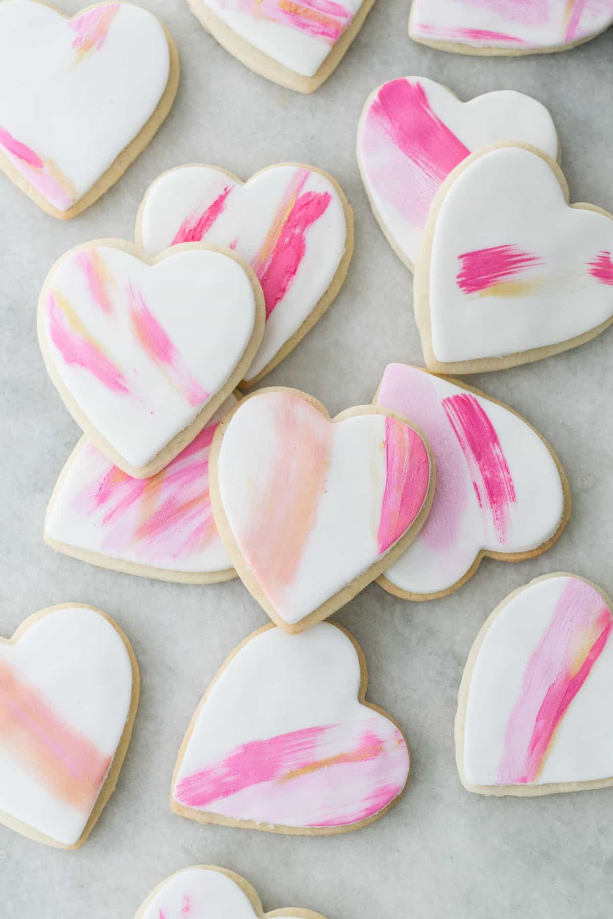 heart shaped frosted sugar cookies on a table