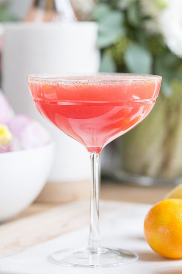 A pretty Easter brunch cocktail in a coupe glass.