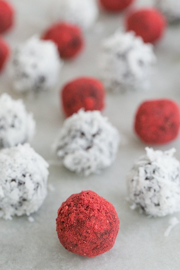 close up of strawberry covered coconut truffles