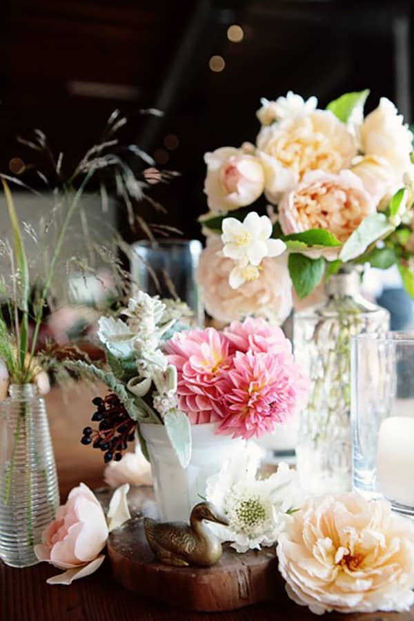 Budget wedding flowers in white vases.