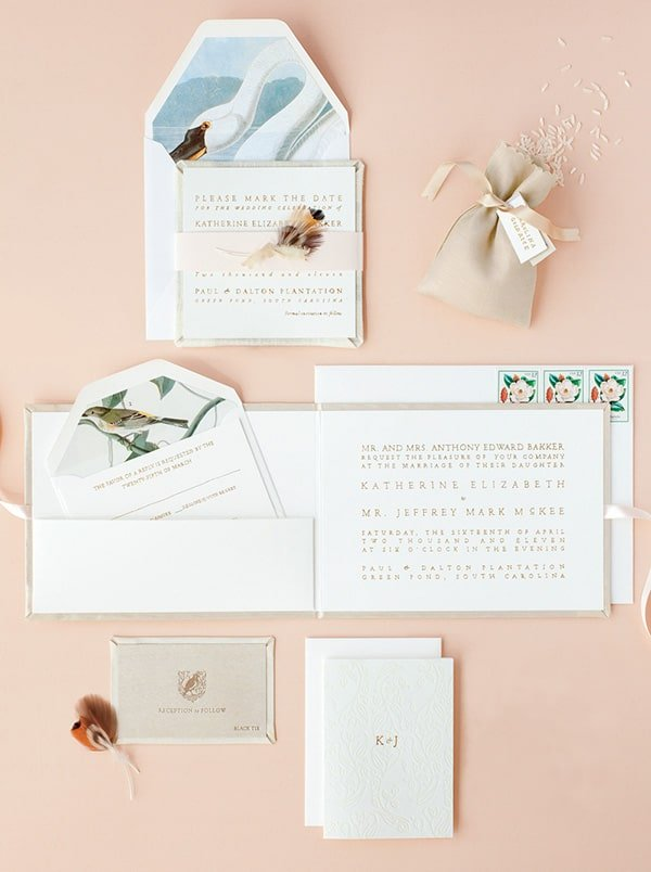 Wedding invitations on a pink background.