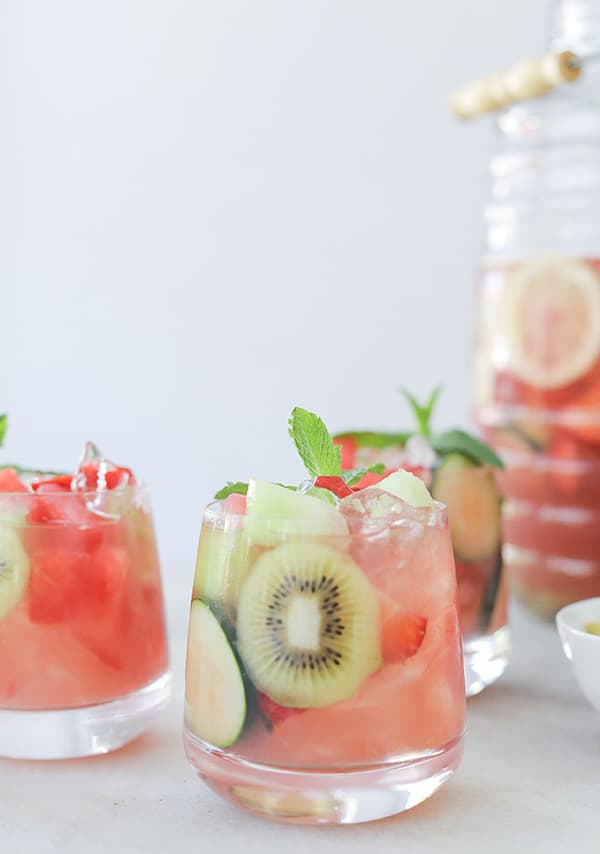 shot of cocktails in glasses with fruit