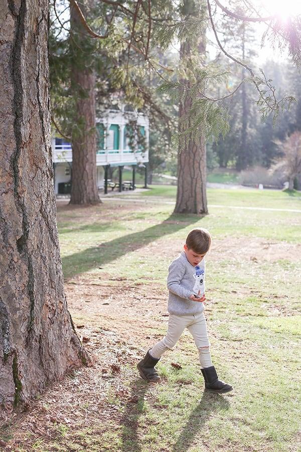 Boy running around in yosemite