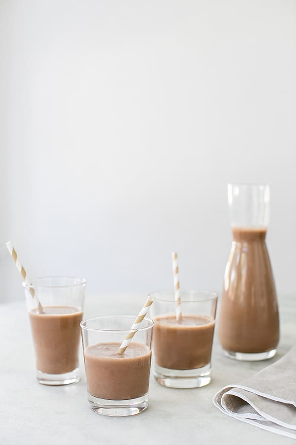 3 glasses of almond chocolate almond milk, side on shot