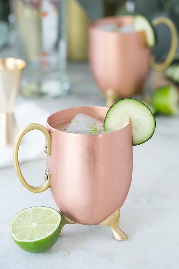 Tokyo Mule Recipe in a copper mug with cucumber.